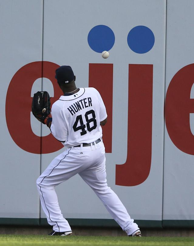 Detroit Tigers right fielder Torii Hunter plays the double by Cleveland Indians' Michael Brantley, off the wall during the first inning in the second baseball game of a doubleheader, Saturday, July 19, 2014 in Detroit. (AP Photo/Carlos Osorio)