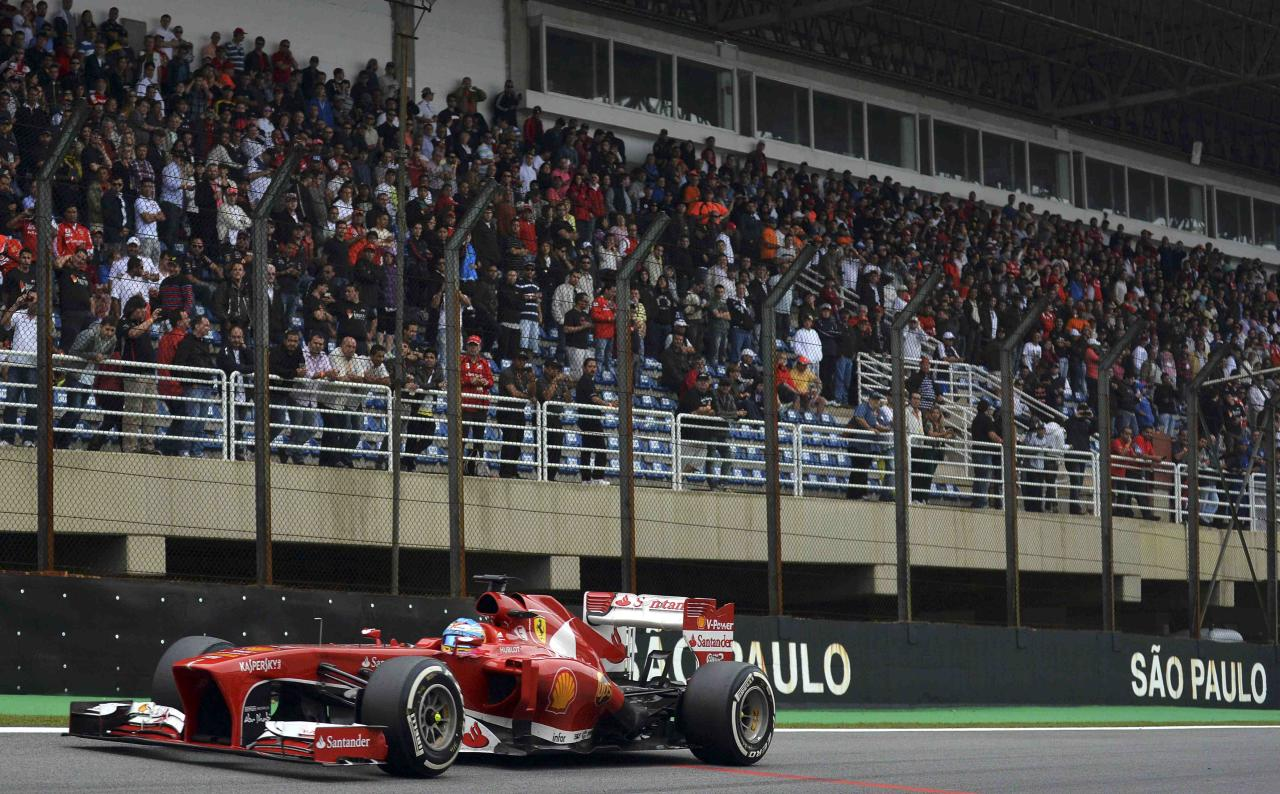 Ferrari Formula One driver Fernando Alonso of Spain drives during the Brazilian F1 Grand Prix at the Interlagos circuit in Sao Paulo November 24, 2013. REUTERS/Nelson Almeida/Pool (BRAZIL - Tags: SPORT MOTORSPORT F1)