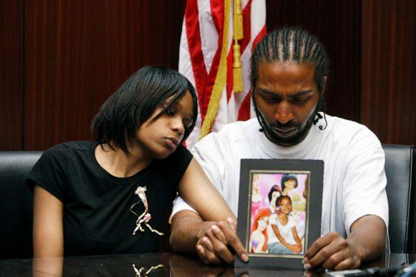 PHOTO: Dominika Stanley, left, the mother of 7-year-old Aiyana Stanley-Jones, sits next to Aiyana's father Charles Jones, who holds a photo of her in Southfield, Mich., May 18, 2010. (Carlos Osorio/AP, FILE)