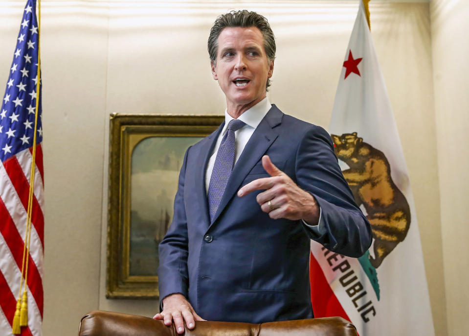FILE - In this July 12, 2019, file photo, California Gov. Gavin Newsom talks with reporters at his office in Sacramento, Calif. On Friday, April 23, 2021, Gov. Newsom announced he would halt all new fracking permits in the state by January 2024. He also ordered state regulators to plan for halting all oil extraction in the state by 2045. (AP Photo/Rich Pedroncelli, File)