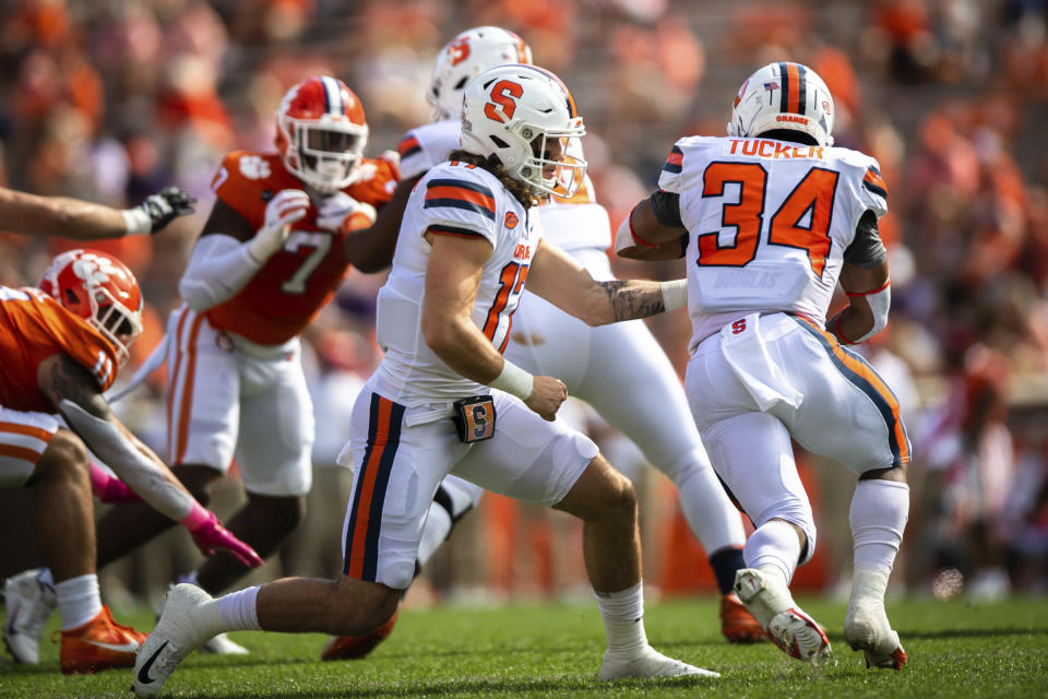Syracuse quarterback Rex Culpepper (17) hands off to Syracuse running back Sean Tucker (34) during an NCAA college football game against Clemson in Clemson, S.C., on Saturday, Oct. 24, 2020. (Ken Ruinard/Pool Photo via AP)