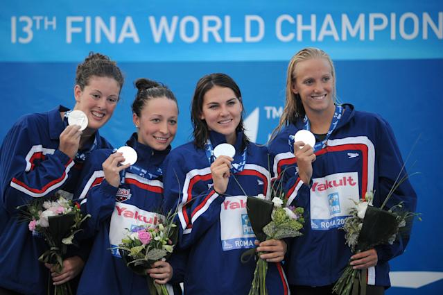Kukors celebrating with teammates Dana Vollmer, Lacey Nymeyer and Allison Schmittafter winningtheir silver medal on the women's 4x200-meter freestyle final on July 30, 2009, at the FINA World Swimming Championships in Rome. (MARTIN BUREAU via Getty Images)