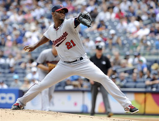 Minnesota Twins pitcher Samuel Deduno delivers thew ball to the New York Yankees during the first inning of a baseball game Saturday, July 13, 2013, at Yankee Stadium in New York. (AP Photo/Bill Kostroun)