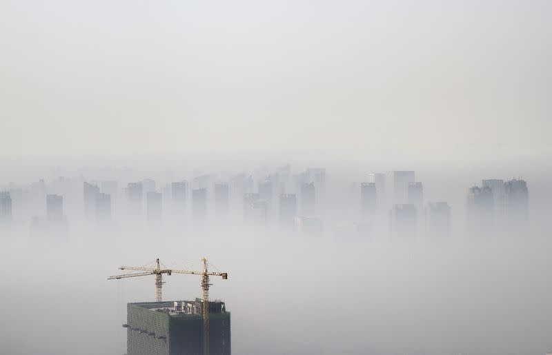 File photo of a building under construction amidst smog on a polluted day in Shenyang