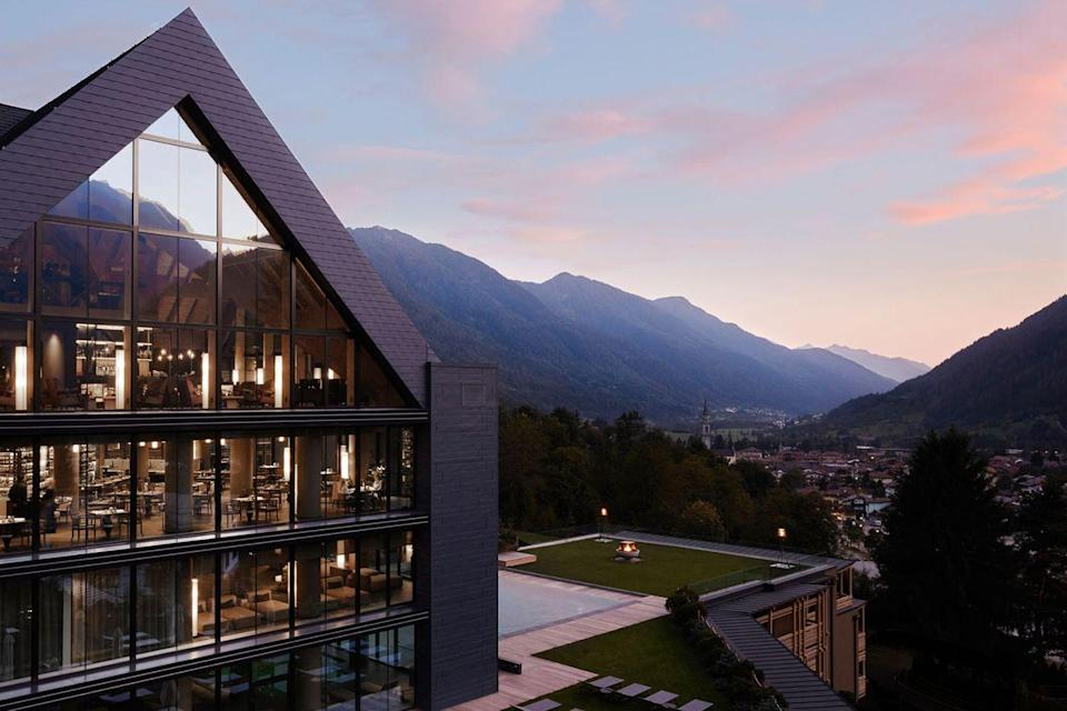 """<p><a class=""""link rapid-noclick-resp"""" href=""""https://dolomiti.lefayresorts.com/en"""" rel=""""nofollow noopener"""" target=""""_blank"""" data-ylk=""""slk:BOOK NOW"""">BOOK NOW</a></p><p><strong>Location</strong><strong>:</strong> <a href=""""https://www.tripadvisor.com/Tourism-g608933-Pinzolo_Province_of_Trento_Trentino_Alto_Adige-Vacations.html"""" rel=""""nofollow noopener"""" target=""""_blank"""" data-ylk=""""slk:Pinzolo, Italy"""" class=""""link rapid-noclick-resp"""">Pinzolo, Italy</a> </p><p>Balance skiing with self-care at this modern wellness mecca set in the middle of the Dolomites. Lefay is built upon the concept of biophilic design, a.k.a. """"healing"""" design that instills a sense of peace and relaxation through scenic mountain views, Zen natural wood, and soul-stirring architecture. </p><p>The property's Scents of the Forest treatment is a sure spa standout, using local alpine plants and flowers to create an indulgent massage, scrub, aromatherapy, and facial treatment. Then, detox in one (or all) of the nine saunas and cool off in the ice and tempered waterfall before dining at one of two Mediterranean, local-fare restaurants. If you're looking for a dose of adrenaline, there is also hiking, horseback riding, dog sledding, paragliding, and mountain biking expeditions on offer.</p>"""