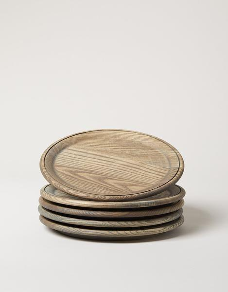 """<p><strong>Farmhouse Pottery</strong></p><p>farmhousepottery.com</p><p><strong>$48.00</strong></p><p><a href=""""https://www.farmhousepottery.com/products/crafted-wooden-plate?_pos=3&_sid=5d9ded2ba&_ss=r&variant=22268460996"""" rel=""""nofollow noopener"""" target=""""_blank"""" data-ylk=""""slk:Shop Now"""" class=""""link rapid-noclick-resp"""">Shop Now</a></p><p>These wooden plates are hand-carved in <a href=""""https://www.farmhousepottery.com/"""" rel=""""nofollow noopener"""" target=""""_blank"""" data-ylk=""""slk:Farmhouse Pottery's"""" class=""""link rapid-noclick-resp"""">Farmhouse Pottery's </a> Vermont workshop using New England Ash. They come in charger sizes as well as different finishes.</p>"""