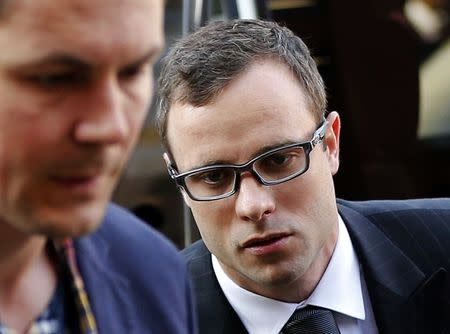 Paralympic track star Oscar Pistorius (C) arrives for the closing arguments of his murder trial at the high court in Pretoria August 7, 2014. REUTERS/Siphiwe Sibeko