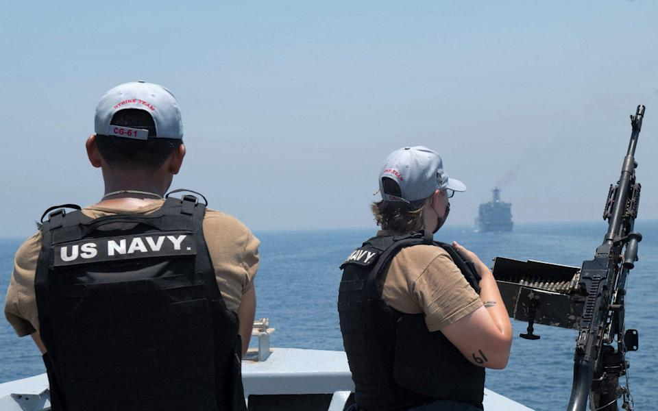 US Navy personnel aboard the guided-missile cruiser USS Monterey (CG 61) looking on while the vessel transits through the Strait of Hormuz. - - Chelsea Palmer/Chelsea Palmer