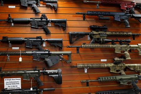 FILE PHOTO - Firearms are shown for sale at the AO Sword gun store in El Cajon