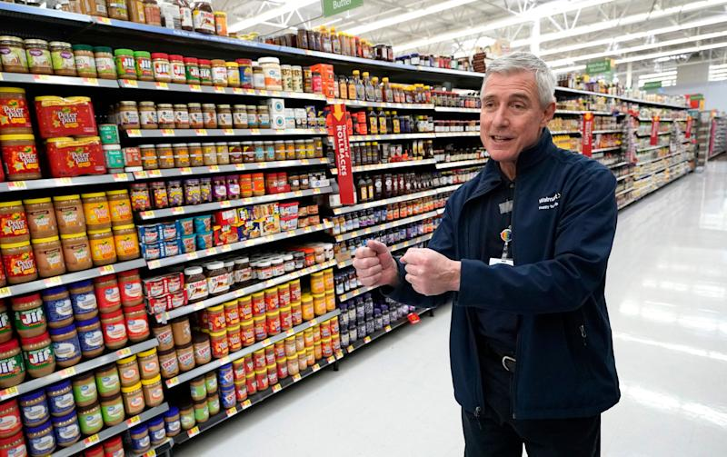 Walmart U.S. President and CEO Greg Foran talks about using a robot to scan shelves and help employees with restocking at a Walmart Supercenter Friday, Nov. 9, 2018, in Houston. (AP Photo/David J. Phillip)