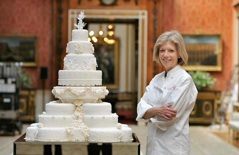 Fiona Cairns stands proudly next to the Royal Wedding cake that she and her team made for Prince William and Kate Middleton, in the Picture Gallery of Buckingham Palace in central London, today.   (Photo by John Stillwell/PA Images via Getty Images)