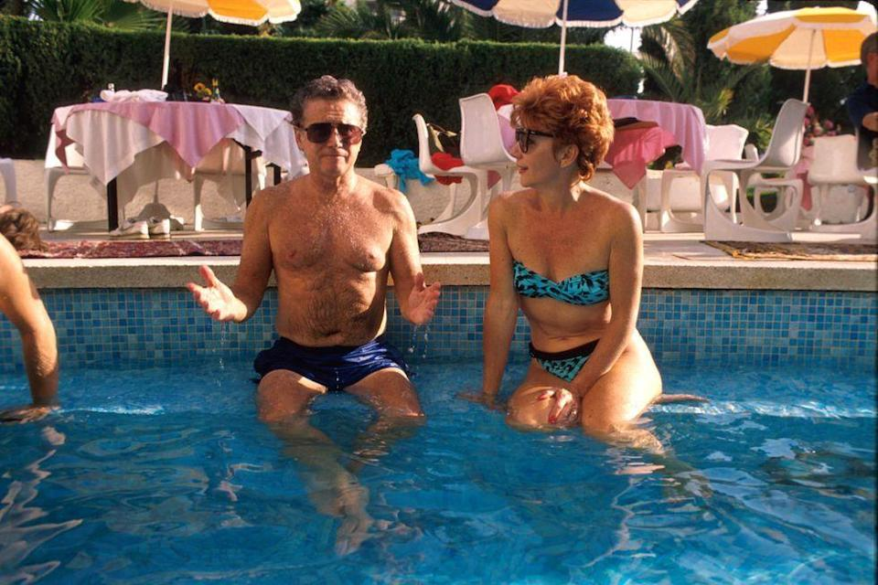 <p>Regis Philbin and his wife Joy enjoy a hotel swimming pool in 1989. </p>
