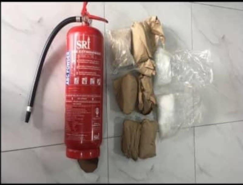 The modified fire extinguisher that had been found to hide the packed narcotics after it was seized by the Johor Narcotics Criminal Investigation Department (NCID) operatives. — Picture courtesy of Johor police