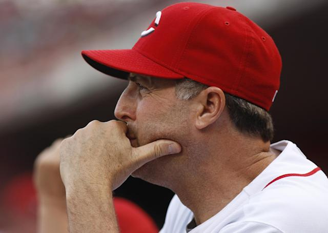 FILE - In this May 26, 2012, file photo, Cincinnati Reds pitching coach Bryan Price watches a baseball game against the Colorado Rockies, in Cincinnati. The Reds have chosen Price to replace Dusty Baker as their next manager, according to a person familiar with the decision. The club plans to introduce the 51-year-old Price at a news conference later Tuesday, Oct. 22, 2013. The person spoke on condition of anonymity because no announcement had been made.(AP Photo/David Kohl, File)