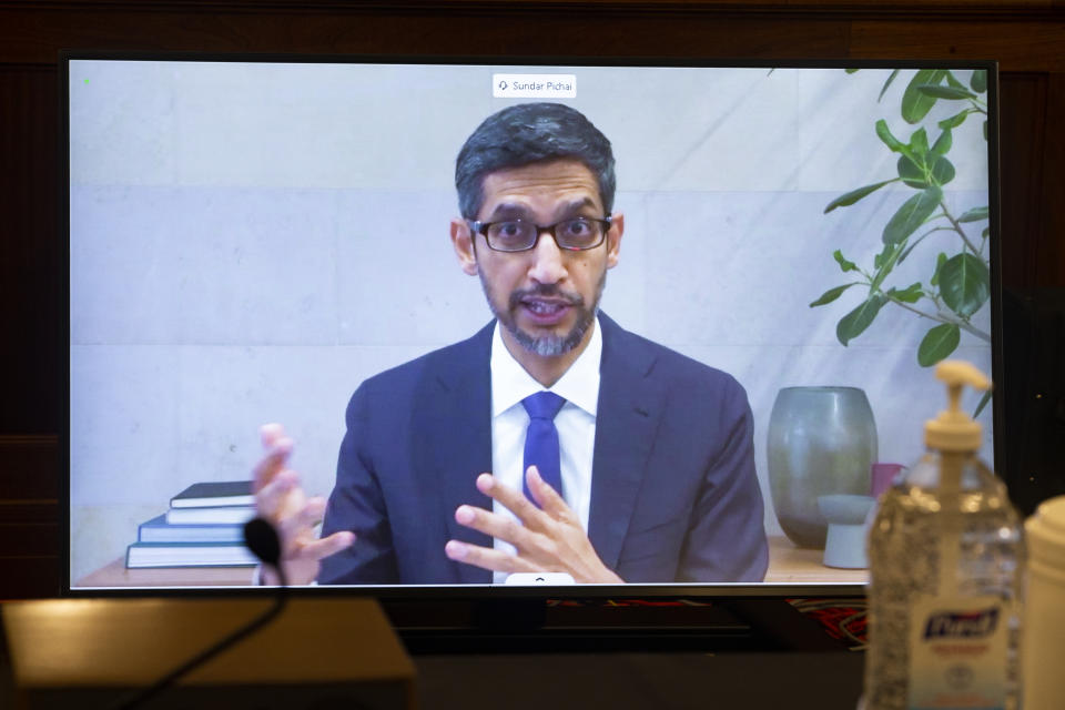 Google CEO Sundar Pichai appears on a screen as he speaks remotely during a hearing before the Senate Commerce Committee on Capitol Hill, Wednesday, Oct. 28, 2020, in Washington. The committee summoned the CEOs of Twitter, Facebook and Google to testify during the hearing. (Michael Reynolds/Pool via AP)