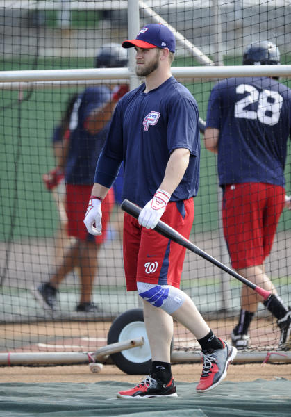 Washington Nationals' Bryce Harper looks on during batting practice as he begins his minor league rehab assignment with the Single-A Potomac Nationals, Tuesday, June 25, 2013, in Woodbridge, Va. The Potomac Nationals play the Myrtle Beach Pelicans. (AP Photo/Nick Wass)