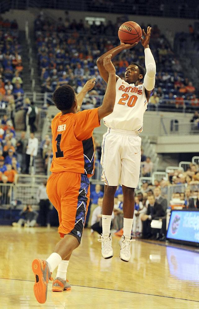 Florida guard Michael Frazier II (20) shoots a 3-pointer over Savannah State guard Alante Fenner (1) during the first half of an NCAA college basketball in Gainesville, Fla., Sunday, Dec. 29, 2013. (AP Photo/Phil Sandlin)