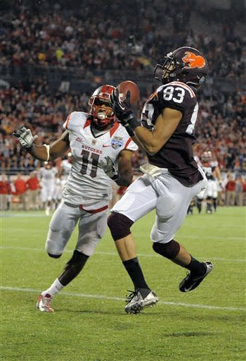 Virginia Tech wide receiver Corey Fuller, right, hauls in a pass in the end zone for a touchdown in front of Rutgers defensive back Logan Ryan, left, during the fourth quarter of an NCAA college football Russell Athletic Bowl game on Friday, Dec. 28, 2012, in Orlando, Fla. (AP Photo/Brian Blanco)