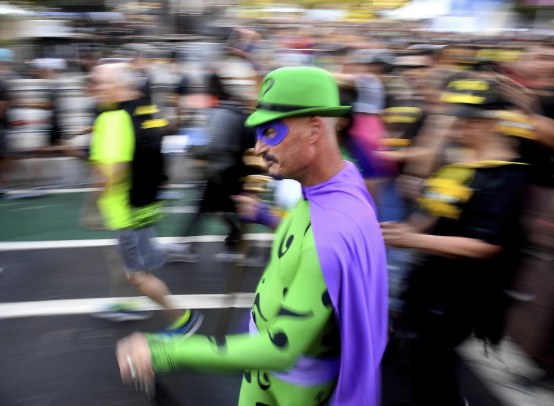 A man dressed in a costume of The Riddler competes the Batman Inaugural 5K run on Batman's 80th anniversary at Grand Park on Saturday, Sept. 21, 2019, in Los Angeles. (Keith Birmingham/The Orange County Register via AP)