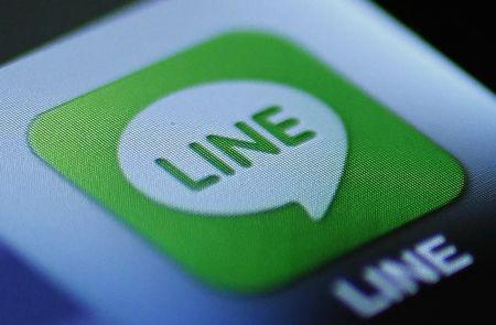 "The icon of a free communication app ""Line"" is pictured on an Apple Inc's iPhone in this photo illustration in Tokyo"