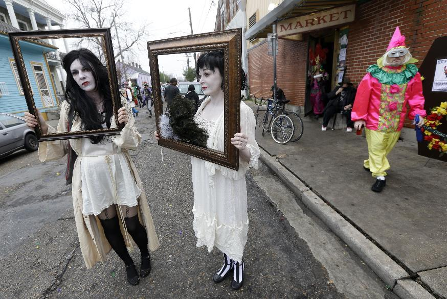 Babbette Hines, left, and Carol Jean Dixon, both of New Orleans, pose with their costumes representing sad ladies of the night, inspired by Storyville photographer E.J. Bellocq, before the start of the Society of Saint Anne walking parade in the Bywater section of New Orleans during Mardi Gras day, Tuesday, Feb. 12, 2013. (AP Photo/Gerald Herbert)