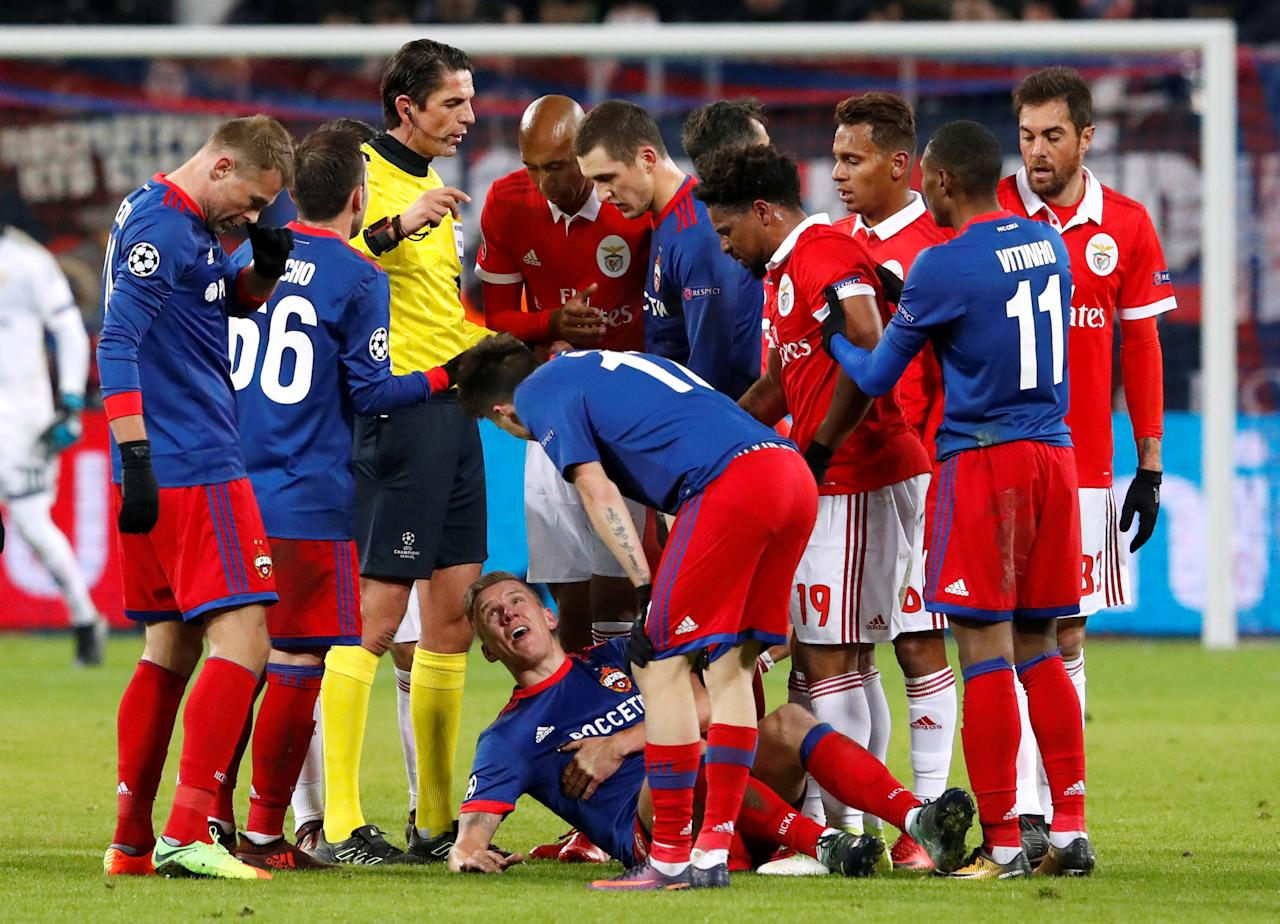 Soccer Football - Champions League - CSKA Moscow vs Benfica - VEB Arena, Moscow, Russia - November 22, 2017  Players surround CSKA Moscow's Pontus Wernbloom after he was fouled   REUTERS/Sergei Karpukhin