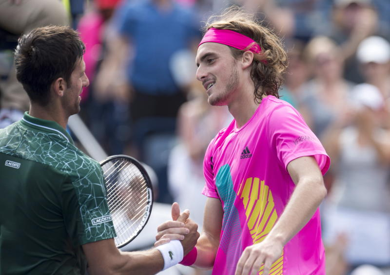 Novak Djokovic left of Serbia congratulates Stefanos Tsitsipas of Greece after their match at the Rogers Cup men's tennis tournament in Toronto Thursday Aug. 9 2018