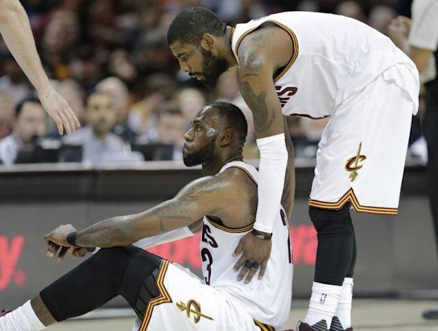 """<a class=""""link rapid-noclick-resp"""" href=""""/nba/players/4840/"""" data-ylk=""""slk:Kyrie Irving"""">Kyrie Irving</a> and <a class=""""link rapid-noclick-resp"""" href=""""/nba/players/3704/"""" data-ylk=""""slk:LeBron James"""">LeBron James</a> in April, before they knew how funny this would look. (AP)"""