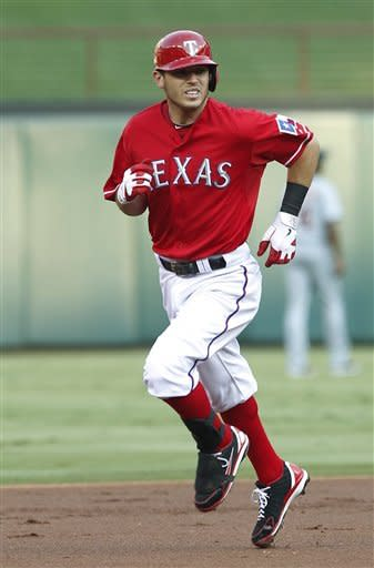 Texas Rangers' Ian Kinsler rounds the bases after hitting a home run off Detroit Tigers pitcher Drew Smyly during the first inning of a baseball game Tuesday, June 26, 2012, in Arlington, Texas. (AP Photo/Tim Sharp)