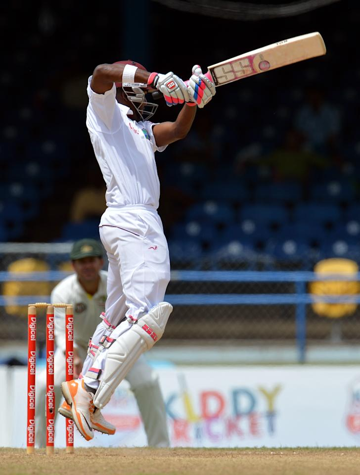 West Indies batsman Darren Bravo hits a four during the third day of the second-of-three Test matches between Australia and West Indies April 17, 2012 at Queen's Park Oval in Port of Spain, Trinidad. AFP PHOTO/Stan HONDA (Photo credit should read STAN HONDA/AFP/Getty Images)