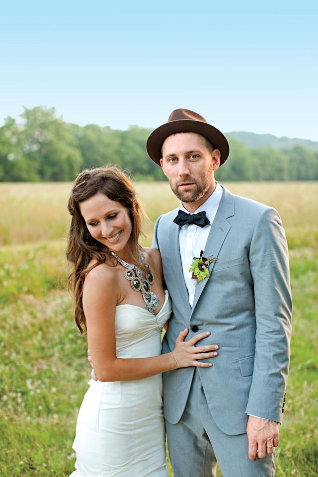 """<p>Annie Sims was a little afraid of how boyfriend <a rel=""""nofollow"""" href=""""http://www.southernliving.com/travel/south-central/musician-mat-kearney-00417000071534"""">Mat Kearney</a>, a musician with a big personality, would propose. """"I thought it might be something huge, but instead he got down on his knee in his bedroom one night while I was helping him pack for a trip,"""" she recalls. """"It was very simple and personal."""" After two years together, the pair began planning for the wedding the very next day. """"We knew we wanted to put our own spin on a classic Southern wedding with the traditional elements,"""" she says of their Tennessee farm affair that was held in a barn and accented with charming vintage touches.</p><p> </p><p><strong>Love It? Get It!<br>Photographer:</strong> <a rel=""""nofollow"""" href=""""http://tecpetaja.com"""">Tec Petaja</a><br><strong>Wedding gown:</strong> <a rel=""""nofollow"""" href=""""http://rivini.com"""">Rivini</a><br><strong>Necklace:</strong> <a rel=""""nofollow"""" href=""""http://poshonline.blogspot.com"""">Posh Boutique</a><br><strong>Groom's Attire:</strong> <a rel=""""nofollow"""" href=""""http://dior.com"""">Christian Dior</a></p>"""