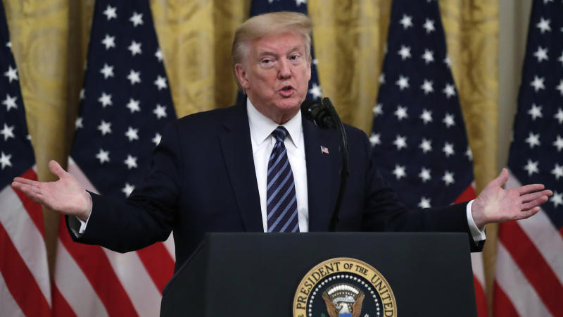 President Donald Trump answers questions from reporters during an event in the East Room of the White House on April 30, 2020, in Washington. (Alex Brandon/AP)