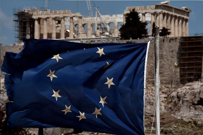 Eurozone finance ministers are urging Greece to swiftly implement the tough reforms at the heart of its huge bailout (AFP Photo/Aris Messinis)