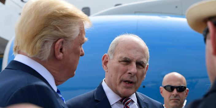 White House Chief of Staff John Kelly, right, listens as President Donald Trump speaks to reporters before boarding Air Force One at Andrews Air Force Base in Md., Friday, May 4, 2018.