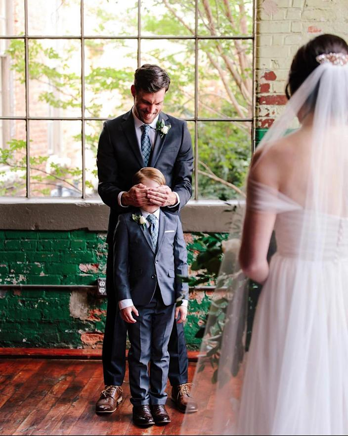 Jude, age 9, gets ready for a surprise on the day his dad, Tyler Seabolt, and stepmom, Rebekah Seabolt, got married. (Ashah Photography)