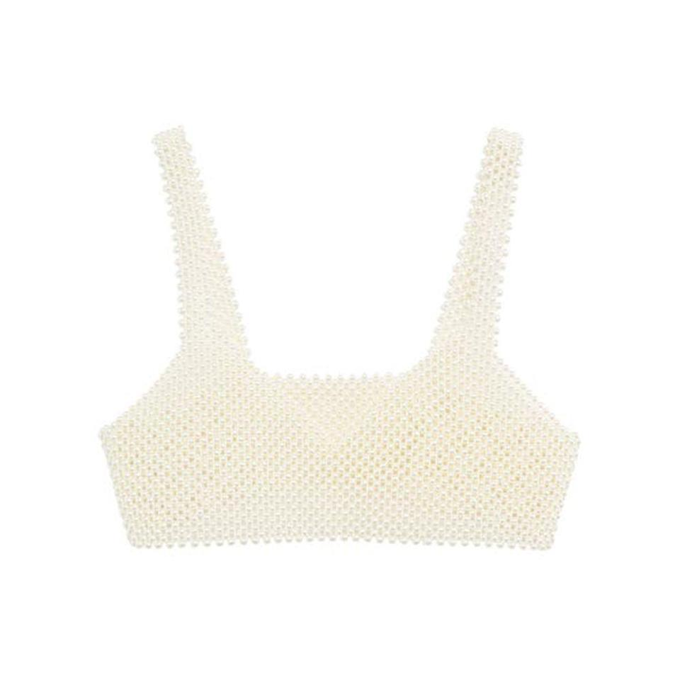 """<p><strong>Mango</strong></p><p>mango.com</p><p><a href=""""https://go.redirectingat.com?id=74968X1596630&url=https%3A%2F%2Fshop.mango.com%2Fus%2Fwomen%2Funderwear-and-lingerie-bralettes%2Fpearl-top_87040008.html&sref=https%3A%2F%2Fwww.elle.com%2Ffashion%2Fshopping%2Fg35279952%2Fbest-fashion-on-sale-2021%2F"""" rel=""""nofollow noopener"""" target=""""_blank"""" data-ylk=""""slk:Shop Now"""" class=""""link rapid-noclick-resp"""">Shop Now</a></p><p><strong><del>$80</del> $60 (25% off)</strong></p><p>Throw this over a plain turtleneck, slip dress or pretty much anything in your closet and voila! An instantly cooler look. </p>"""