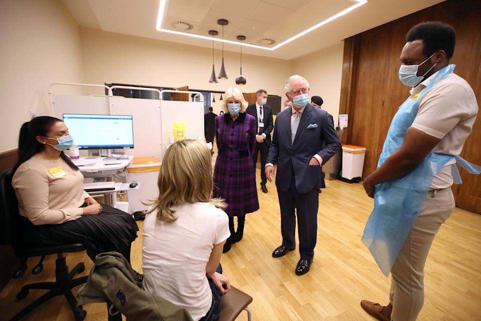 BIRMINGHAM, ENGLAND - FEBRUARY 17: Prince Charles, Prince of Wales and Camilla, Duchess of Cornwall speaks to members of staff during a visit to The Queen Elizabeth Hospital on February 17, 2021 in Birmingham, England. (Photo by Molly Darlington - WPA Pool/Getty Images)