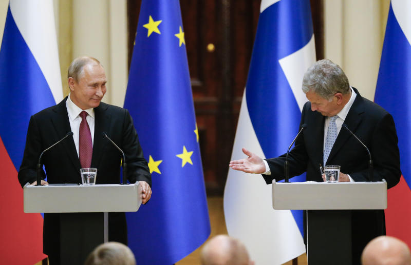 President of the Republic of Finland Sauli Niinisto, right, and Russian President Vladimir Putin speak during a news conference after their meeting at the President's official residence Mantyniemi in Helsinki, Finland, Wednesday, Aug. 21, 2019. (AP Photo/Alexander Zemlianichenko, Pool)