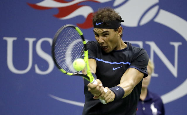 FILE - In this Sept. 2, 2016, file photo, Rafael Nadal, of Spain, returns a shot to Andrey Kuznetsov, of Russia, during the U.S. Open tennis tournament in New York.Nadal is not sure he will try to defend his title if the Open is held at all. A decision by the U.S. Tennis Association about whether to have its marquee event is expected as soon as next week. (AP Photo/Julio Cortez, File)
