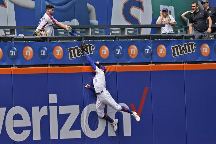 New York Mets center fielder Brandon Nimmo can't grab a home run hit by Pittsburgh Pirates' Michael Perez during the fifth inning of a baseball game at Citi Field, Sunday, July 11, 2021, in New York. (AP Photo/Seth Wenig)