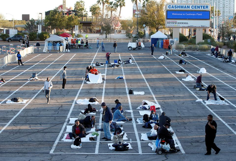 Homeless people get settled in a temporary parking lot shelter at Cashman Center, with spaces marked for social distancing to help slow the spread of coronavirus disease in Las Vegas. (Photo: Steve Marcus / Reuters)