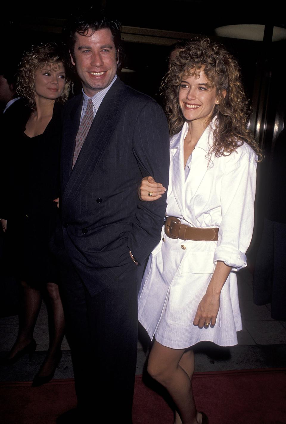 John Travolta and Kelly Preston attend the 'Hudson Hawk' Westwood Premiere on May 20, 1991 at Mann National Theatre in Westwood, California. (Photo by Ron Galella, Ltd./Ron Galella Collection via Getty Images)