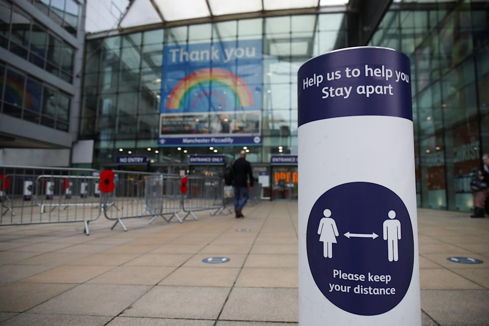 A social distancing sign is seen at the entrance to Manchester Piccadilly station is seen amid the coronavirus disease (COVID-19) pandemic in Manchester, Britain, November 11, 2020. REUTERS/Molly Darlington