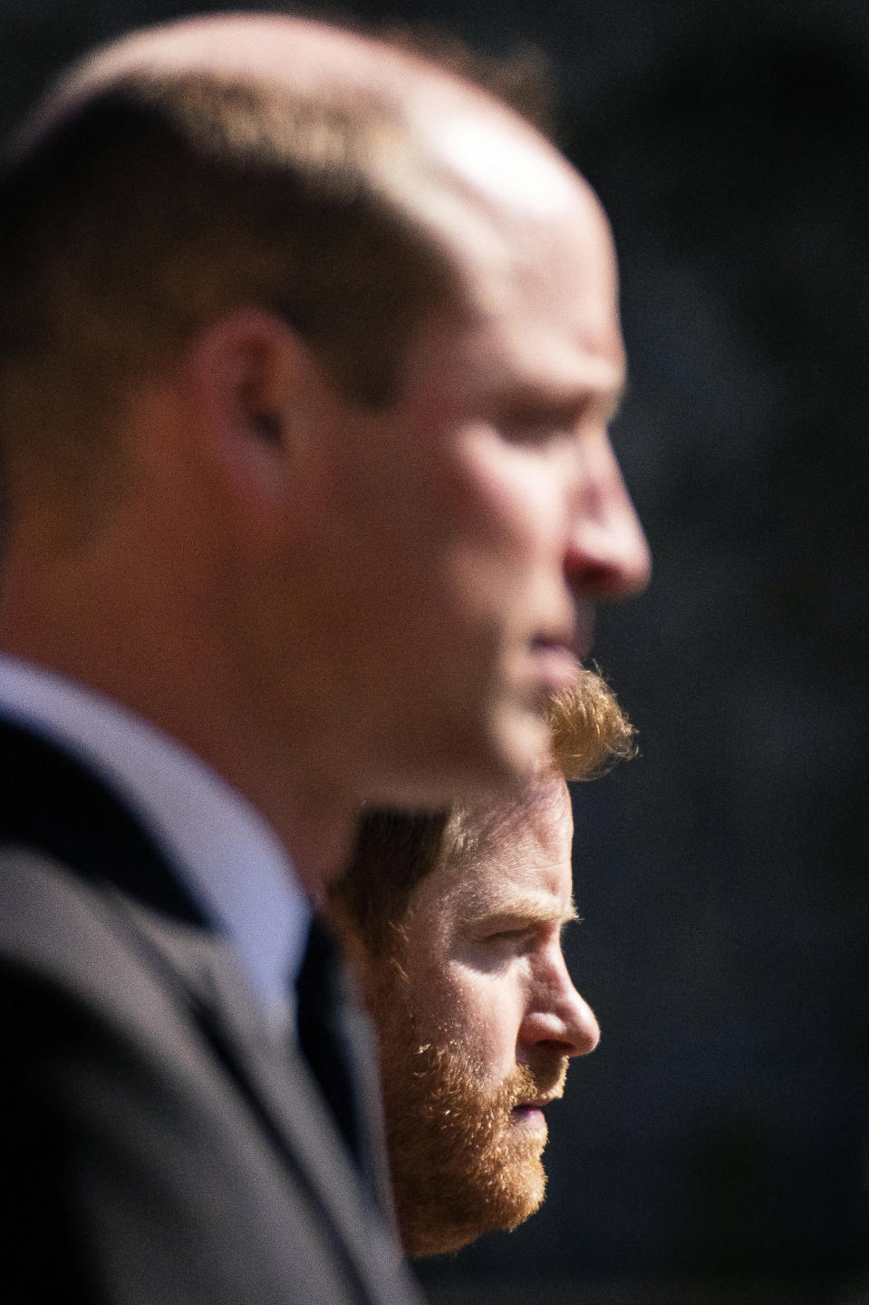 Prince William, the Duke of Cambridge and Prince Harry walk in the procession, ahead of Britain Prince Philip's funeral at Windsor Castle, Windsor, England, Saturday April 17, 2021. Prince Philip died April 9 at the age of 99 after 73 years of marriage to Britain's Queen Elizabeth II. (Victoria Jones/Pool via AP)