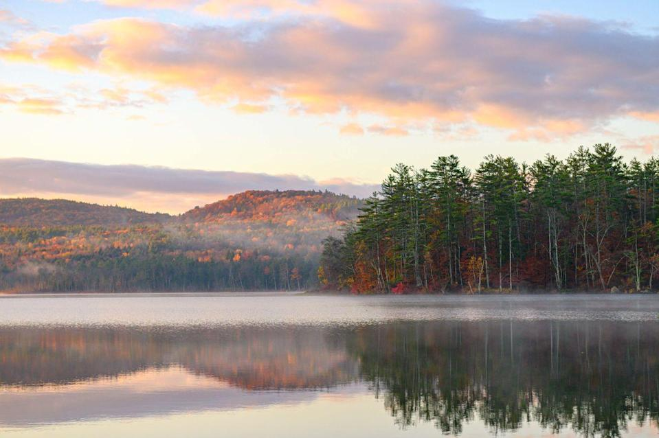 """<p>Located in the Eastern White Mountains of New Hampshire, North Conway is a cozy little slice of New England with some of the most intricate fall foliage to enjoy. You can browse the mountains' <a href=""""https://www.visitwhitemountains.com/foliage-tracker"""" rel=""""nofollow noopener"""" target=""""_blank"""" data-ylk=""""slk:annual foliage tracker"""" class=""""link rapid-noclick-resp"""">annual foliage tracker</a> for color updates, and when you get there, a <a href=""""https://www.conwayscenic.com/valley-train/"""" rel=""""nofollow noopener"""" target=""""_blank"""" data-ylk=""""slk:Conway Scenic Railroad"""" class=""""link rapid-noclick-resp"""">Conway Scenic Railroad</a> excursion can lead your tour.</p>"""