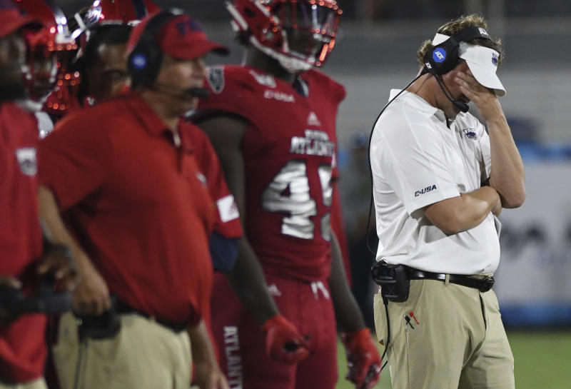 Florida Atlantic coach Lane Kiffin looks down during the second half of the team's NCAA college football game against UCF on Saturday, Sept. 7, 2019, in Boca Raton, Fla. (AP Photo/Jim Rassol)