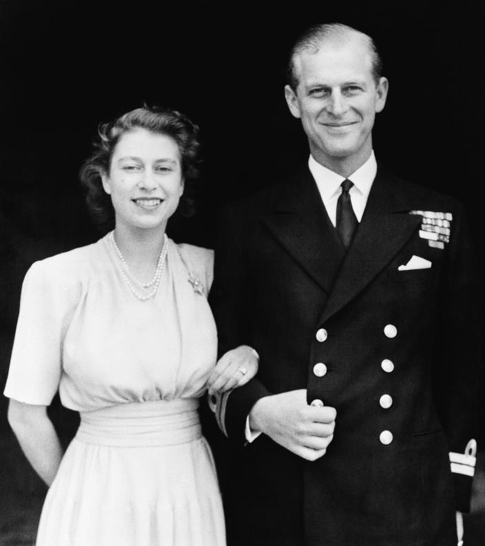 FILE - This July 10, 1947 official photo shows Britain's Princess Elizabeth, heir presumptive to the British throne and her fiance, Lieut. Philip Mountbatten, in London. Prince Philip was born into the Greek royal family but spent almost all of his life as a pillar of the British one. His path was forged when he married the heir to the British throne, and a promising naval career was cut short when his wife suddenly became Queen Elizabeth II. Nevertheless, he set about forging a place for himself as royal consort. He was a patron of charities and a supporter of projects for young people. He was married for more than 73 years and was still carrying out royal engagements into his late 90s. (AP Photo/File)