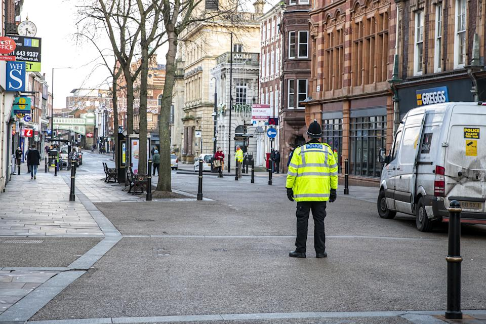 A police officer patrols an empty High Street in Worcester city centre, Worcestershire, on the first day of the third national lockdown in England, to reduce the spread of COVID-19. Prime Minister Boris Johnson announced further coronavirus restrictions during a televised address to the nation last night.