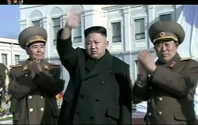 In this Feb. 16, 2013 image made from video, North Korean leader Kim Jong Un, center, waves as he attends a statue unveiling ceremony at Mangyongdae Revolutionary School in Pyongyang, North Korea on the anniversary of late North Korean leader Kim Jong Il's birthday. (AP Photo/KRT via AP Video) TV OUT, NORTH KOREA OUT