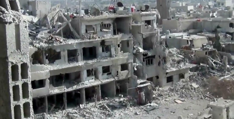 This image taken from video obtained from the Shaam News Network, which has been authenticated based on its contents and other AP reporting, shows damaged buildings due to heavy shelling in the Damascus suburb of Daraya, Syria, on Wednesday, April 3, 2013. (AP Photo/Shaam News Network via AP video)